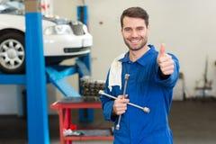 Smiling mechanic looking at camera Stock Photo