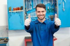 Smiling mechanic looking at camera Stock Image