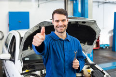 Smiling mechanic looking at camera Royalty Free Stock Image