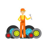 Smiling Mechanic And MAny Wheels In The Garage, Car Repair Workshop Service Illustration. Cartoon Male Character In Dungarees Working In Auto Repair Shop Stock Image