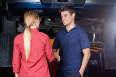 Smiling Mechanic Shaking Hand With Customer Royalty Free Stock Photo