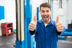 Smiling mechanic showing thumbs up Royalty Free Stock Photo