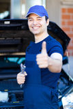 Smiling mechanic thumbs up stock images