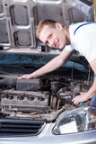 Smiling mechanic at work Royalty Free Stock Photo