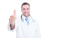 Smiling medic or doctor showing thumb up or like gesture. With one hand isolated on white background with advertising area royalty free stock photos