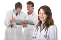 Smiling medical doctor with her colleagues Royalty Free Stock Images