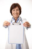 Smiling medical doctor holding clipboard Royalty Free Stock Photo