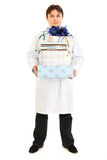 Smiling medical doctor holding gifts in hands Royalty Free Stock Photo