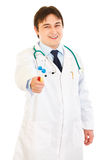 Smiling medical doctor holding test tubes in hand Stock Photography