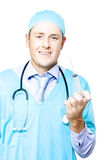 Smiling medical doctor with needle and syringe Stock Photo