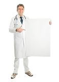 Smiling medical doctor presenting empty board. Smiling senior medical doctor presenting empty board. Isolated on white Royalty Free Stock Photos