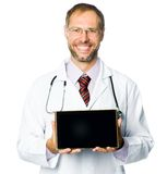 Smiling medical doctor show a tablet pc Royalty Free Stock Photos