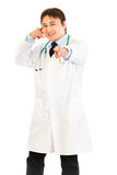 Smiling medical doctor showing contact me gesture Stock Photo