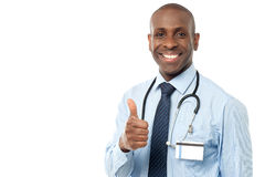 Smiling medical doctor showing thumbs up Stock Photo