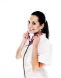 Smiling medical doctor with stethoscope. Isolated over white background Stock Photography