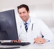 Smiling Medical Doctor With Stethoscope Royalty Free Stock Photography