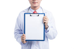Smiling medical doctor with stethoscope showing blank folder ove Royalty Free Stock Photos