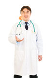 Smiling medical doctor throwing up apple Stock Image