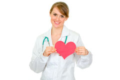 Smiling medical doctor woman holding paper heart Stock Photos