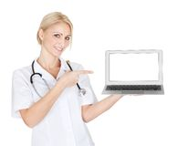 Smiling medical doctor woman presenting laptop stock photos