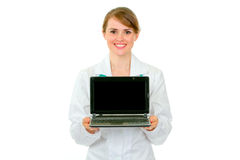 Smiling medical doctor woman showing laptops Stock Image