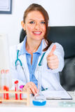 Smiling medical doctor woman showing thumbs up Stock Image