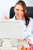 Smiling medical doctor woman working on computer Stock Photos