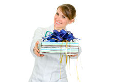 Smiling medical female doctor holding gift Stock Photos