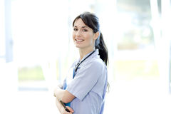 Smiling medical female with stethoscope Royalty Free Stock Photo