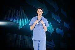 Smiling medical intern wearing a blue shortsleeve uniform royalty free stock photos