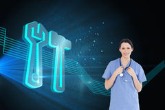 Smiling medical intern wearing a blue shortsleeve uniform. Composite image of young and confident medical intern wearing a blue shortsleeve uniform Royalty Free Stock Photo