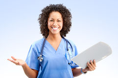 Smiling medical nurse. With stethoscope. Over blue background Stock Photos