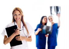 Smiling medical people. With stethoscopes. Doctors and nurses over white background Stock Photography