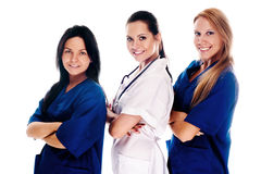Smiling medical people. With stethoscopes. Doctors and nurses over white background Stock Image