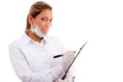 Smiling medical professional with writing pad Stock Photos