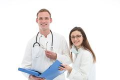 Smiling medical team discussing patient records Royalty Free Stock Image