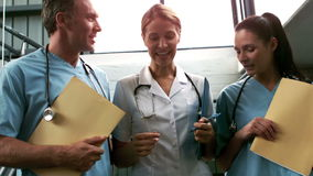 Smiling medical team going down the stairs stock footage