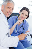 A smiling medical team looking a document Royalty Free Stock Photos