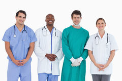 Smiling medical team standing together Royalty Free Stock Image