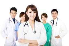 Smiling Medical team standing together isolated on white stock photo