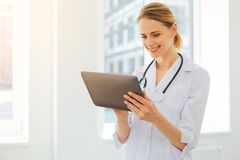 Smiling medical worker using tablet computer at work Royalty Free Stock Photography