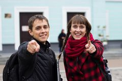 Man and girl pointing fingers to you royalty free stock photography