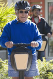 Smiling men on segways Royalty Free Stock Photo
