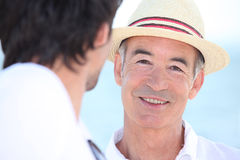Smiling men in the sunshine Stock Photo