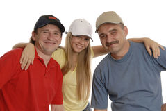 Smiling men and a woman. 2 men in sport clothes and the girl in the middle is hugging them Royalty Free Stock Photo