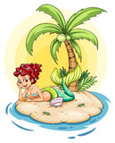 A smiling mermaid in an island Royalty Free Stock Images