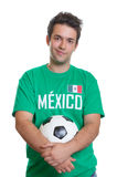 Smiling mexican football fan with ball Royalty Free Stock Photos