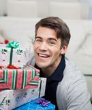 Smiling Mid Adult Man With Christmas Gifts Royalty Free Stock Photos