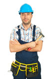Smiling mid adult workman with hammer Stock Photography