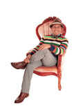 Smiling middle age man in armchair. Stock Photos
